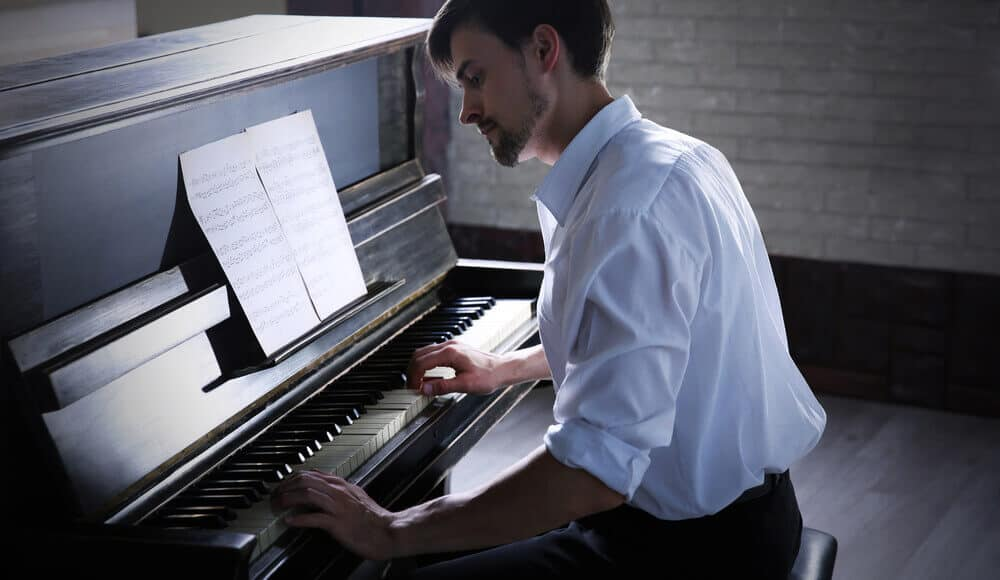 Adult beginner learn how to play acoustic upright piano.
