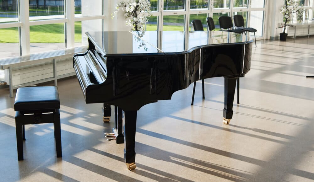 Polished and clean black grand piano.