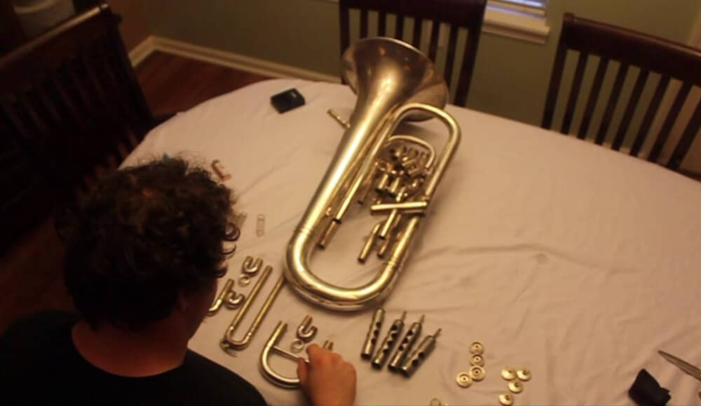Musician is disassembling, cleaning, washing and polishing Euphonium.