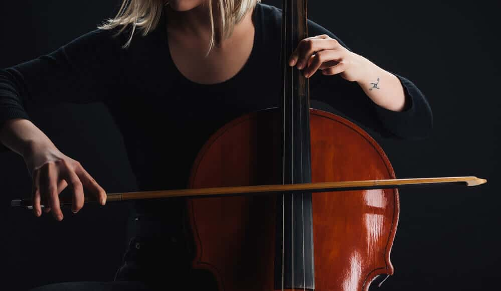 Musician playing double bass instrument.