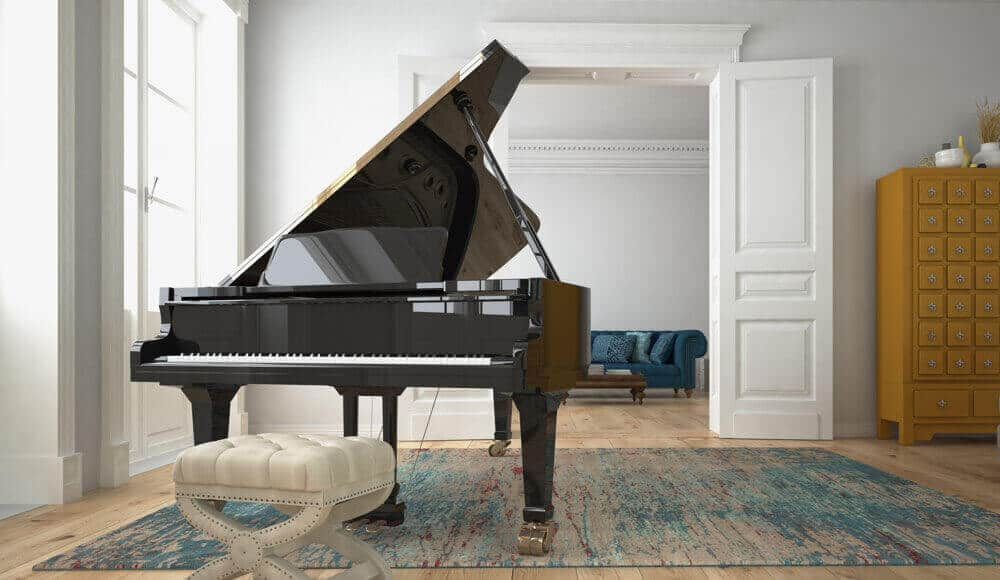 A Grand piano place in the middle of a room.