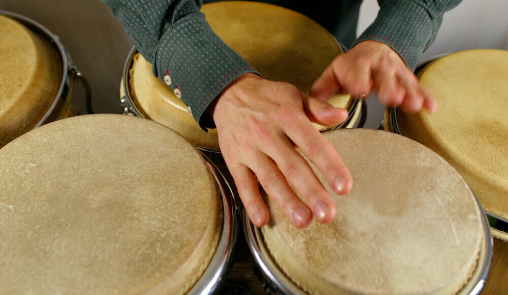 Musician playing hand drums.