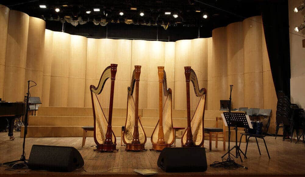Different types of harps on the stage.