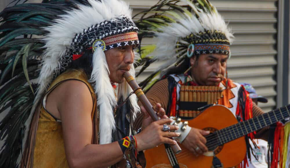 Native American musicians performing live on the street.