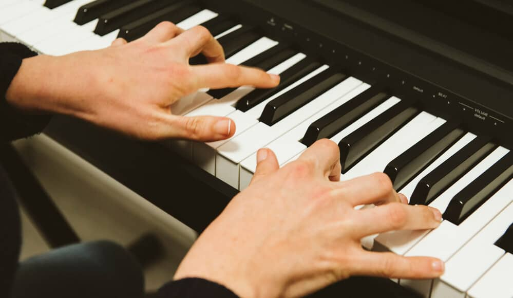 Pianist Stretch his hands while playing piano.