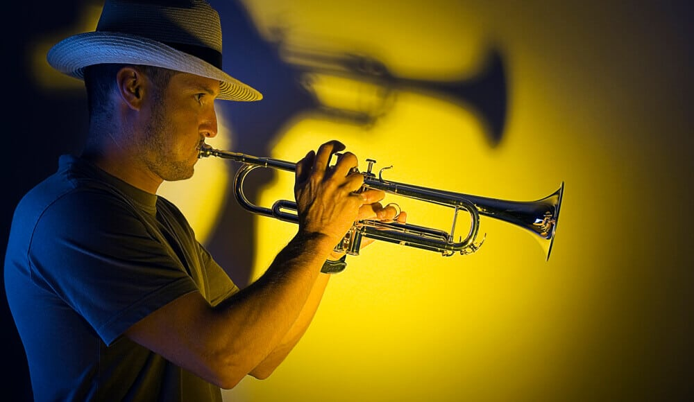 Musician is playing jazz music with trumpet.