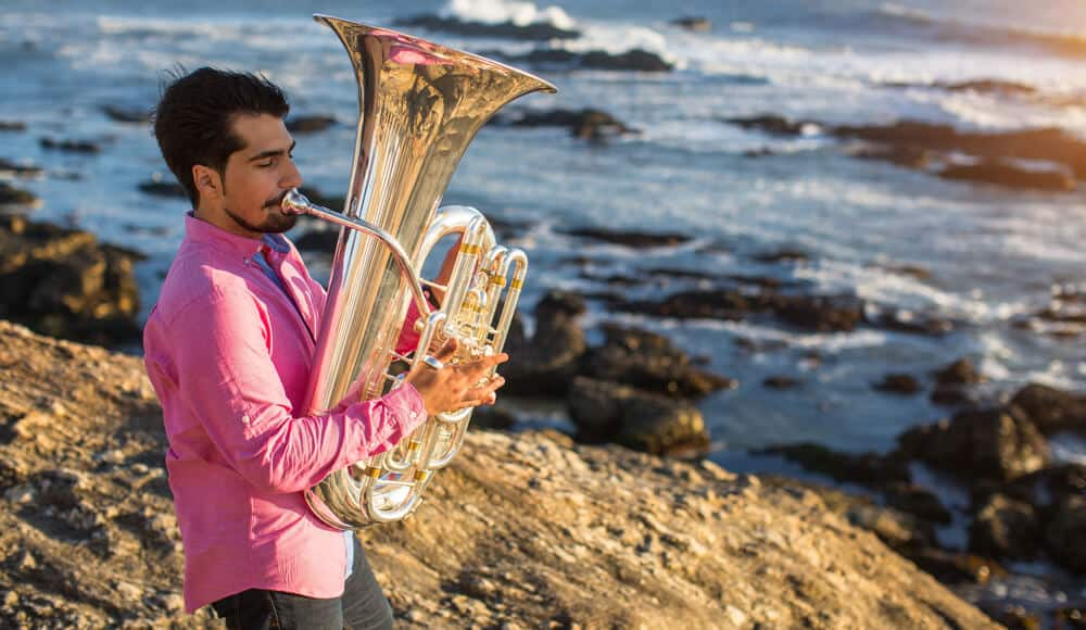 Tuba player on the beach.