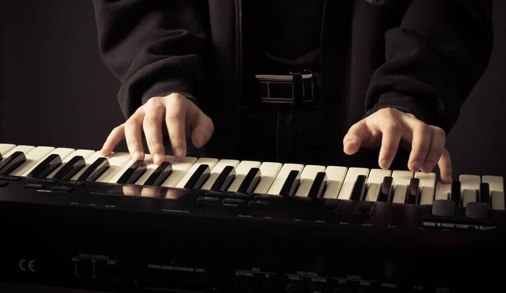 Pianist with smaller hands is playing the customized-size piano.